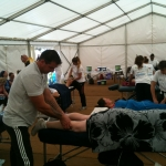Innersights student Zoli providing a fantastic sports massage treatment to a runner from Reigate Half Marathon